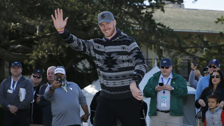 Kyle Rudolph waves to the crowd.