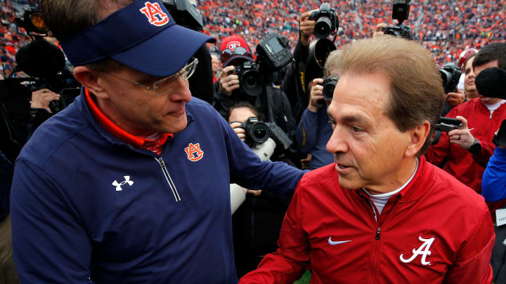 AUBURN, AL - NOVEMBER 25:  (L-R) Head coaches Gus Malzahn of the Auburn Tigers and Nick Saban of the Alabama Crimson Tide meet on the field prior to their game at Jordan Hare Stadium on November 25, 2017 in Auburn, Alabama.  (Photo by Kevin C. Cox/Getty Images)