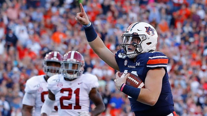 Auburn QB Bo Nix celebrates a score in the 2019 Iron Bowl against the Alabama Crimson Tide.