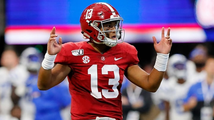 ATLANTA, GEORGIA - AUGUST 31:  Tua Tagovailoa #13 of the Alabama Crimson Tide reacts after passing for a touchdown in the first half against the Duke Blue Devils at Mercedes-Benz Stadium on August 31, 2019 in Atlanta, Georgia. (Photo by Kevin C. Cox/Getty Images)