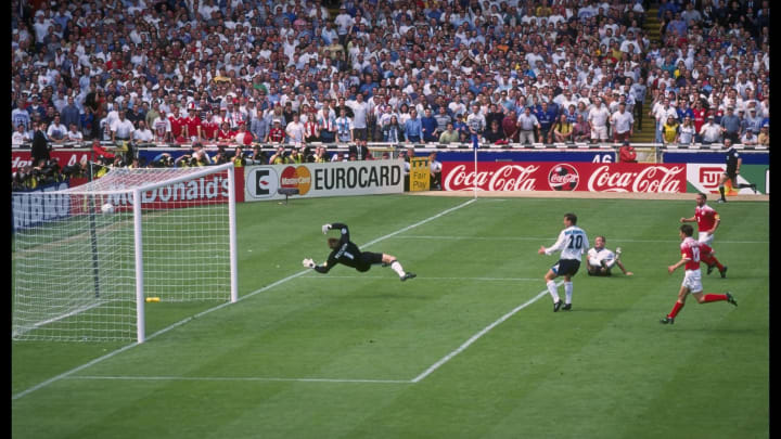 Alan Shearer of England scores England's opening goal as Teddy Sheringham (number 10) looks on