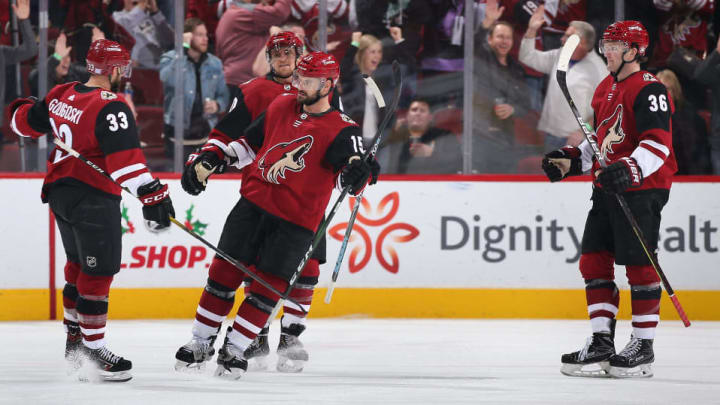 GLENDALE, ARIZONA - NOVEMBER 27: (L-R) Alex Goligoski #33, Michael Grabner #40, Brad Richardson #15 and Christian Fischer #36 of the Arizona Coyotes celebrate after Goligoski scored a goal against the Anaheim Ducks during the third period of the NHL game at Gila River Arena on November 27, 2019 in Glendale, Arizona. The Coyotes defeated the Ducks 4-3 in an overtime shootout.  (Photo by Christian Petersen/Getty Images)