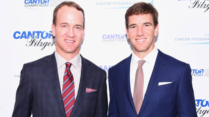 NEW YORK, NY - SEPTEMBER 12:  Former NFL player Peyton Manning and NY Giants, NFL player Eli Manning attend the Annual Charity Day hosted by Cantor Fitzgerald, BGC and GFI at Cantor Fitzgerald on September 12, 2016 in New York City.  (Photo by Dave Kotinsky/Getty Images for Cantor Fitzgerald)