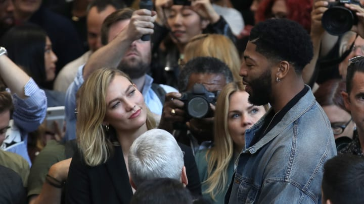 CUPERTINO, CALIFORNIA - SEPTEMBER 10: Model Karlie Kloss (L) and Los Angeles Lakers player Anthony Davis (R) talk with Apple CEO Tim Cook (C) during a special event on September 10, 2019 in the Steve Jobs Theater on Apple's Cupertino, California campus. Apple unveiled several new products including an iPhone 11, iPhone 11 Pro, Apple Watch Series 5 and seventh-generation iPad.  (Photo by Justin Sullivan/Getty Images)
