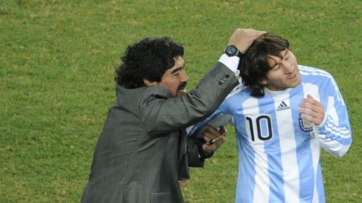 Argentina's coach Diego Maradona (L) and