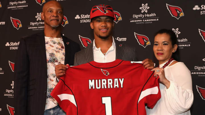 TEMPE, ARIZONA - APRIL 26: Quarterback Kyler Murray of the Arizona Cardinals poses with father Kevin and mother Missy during a press conference at the Dignity Health Arizona Cardinals Training Center on April 26, 2019 in Tempe, Arizona. Murray was the first pick overall by the Arizona Cardinals in the 2019 NFL Draft. (Photo by Christian Petersen/Getty Images)
