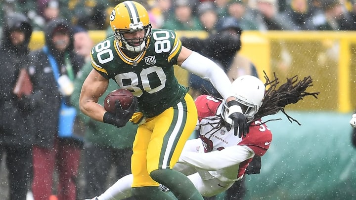 GREEN BAY, WI - DECEMBER 02:  Jimmy Graham #80 of the Green Bay Packers avoids being tackled by Tre Boston #33 of the Arizona Cardinals during the first half of a game at Lambeau Field on December 2, 2018 in Green Bay, Wisconsin.  (Photo by Stacy Revere/Getty Images)