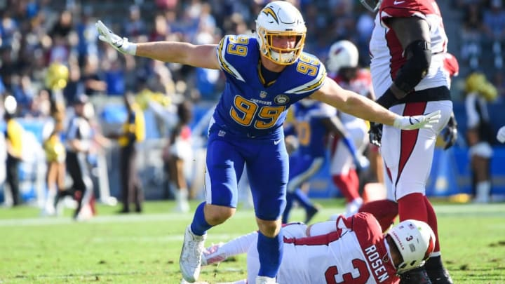 CARSON, CA - NOVEMBER 25: Defensive end Joey Bosa #99 of the Los Angeles Chargers celebrates his sack of quarterback Josh Rosen #3 of the Arizona Cardinals in the second quarter at StubHub Center on November 25, 2018 in Carson, California. (Photo by Harry How/Getty Images)