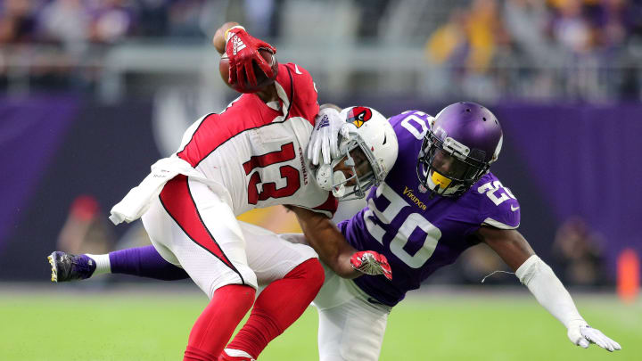 MINNEAPOLIS, MN - OCTOBER 14: Christian Kirk #13 of the Arizona Cardinals is tackled with the ball by Mackensie Alexander #20 of the Minnesota Vikings in the fourth quarter of the game at U.S. Bank Stadium on October 14, 2018 in Minneapolis, Minnesota. (Photo by Adam Bettcher/Getty Images)