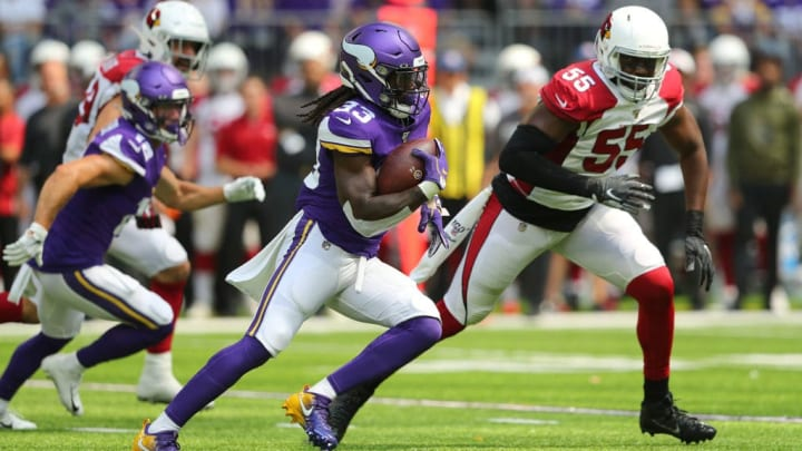 MINNEAPOLIS, MN - AUGUST 24:  Dalvin Cook #33 of the Minnesota Vikings carries the ball for a touchdown in the first quarter of pre-season play against the Arizona Cardinals at U.S. Bank Stadium on August 24, 2019 in Minneapolis, Minnesota. (Photo by Adam Bettcher/Getty Images)