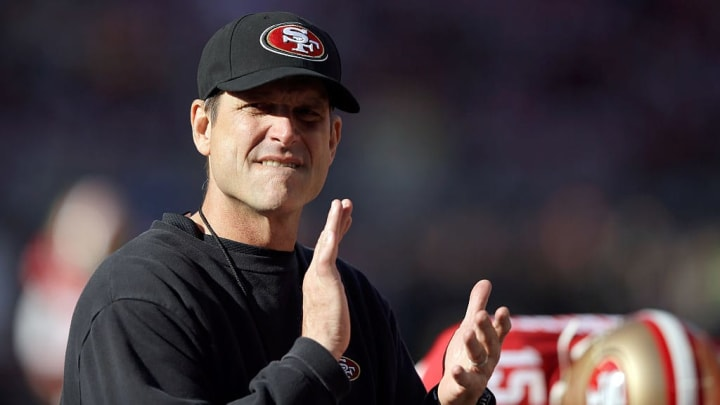 SANTA CLARA, CA - DECEMBER 28:  Head coach Jim Harbaugh of the San Francisco 49ers stands on the field before their game against the Arizona Cardinals at Levi's Stadium on December 28, 2014 in Santa Clara, California.  (Photo by Ezra Shaw/Getty Images)