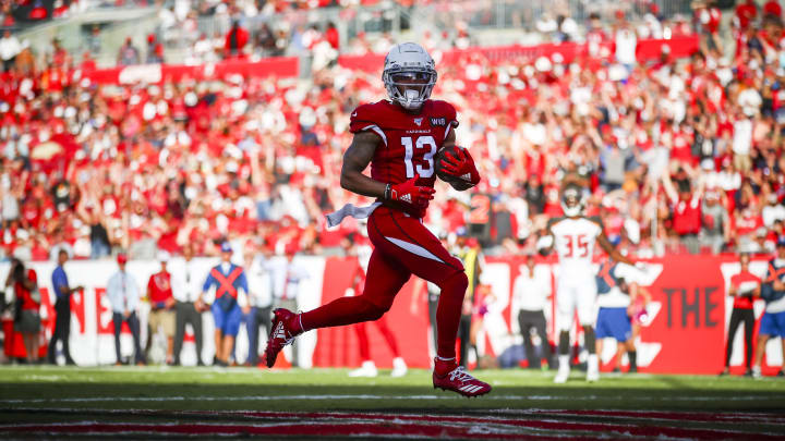 TAMPA, FL - NOVEMBER 10: Christian Kirk #13 of the Arizona Cardinals holds on to the pass from Kyler Murray #1 for a touchdown in the fourth quarter during the game against the Tampa Bay Buccaneers on November 10, 2019 at Raymond James Stadium in Tampa, Florida. (Photo by Will Vragovic/Getty Images)