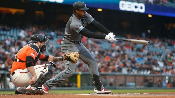 SAN FRANCISCO, CALIFORNIA - MAY 24: Adam Jones #10 of the Arizona Diamondbacks hits a single in the top of the first inning against the San Francisco Giants at Oracle Park on May 24, 2019 in San Francisco, California. (Photo by Lachlan Cunningham/Getty Images)