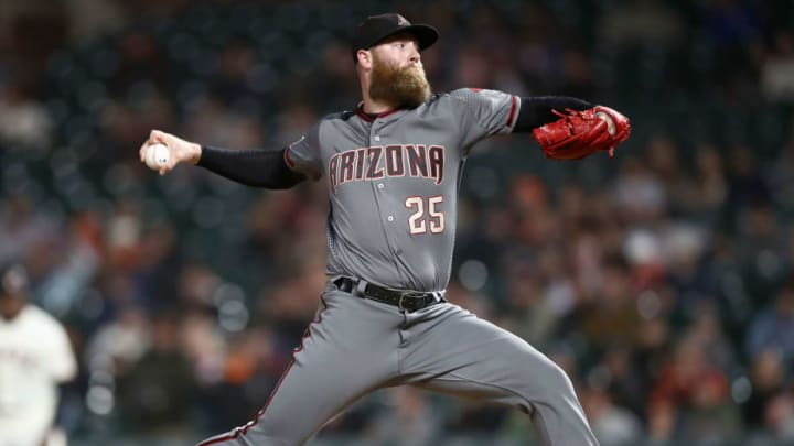 SAN FRANCISCO, CALIFORNIA - AUGUST 27:  Archie Bradley #25 of the Arizona Diamondbacks pitches against the San Francisco Giants at Oracle Park on August 27, 2019 in San Francisco, California. (Photo by Ezra Shaw/Getty Images)