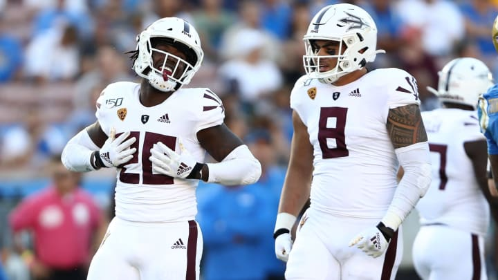 LOS ANGELES, CALIFORNIA - OCTOBER 26:  Khaylan Kearse-Thomas #20 and Merlin Robertson #8 of the Arizona State Sun Devils react to tackling Dorian Thompson-Robinson #1 of the UCLA Bruins during the first half of a game on October 26, 2019 in Los Angeles, California. (Photo by Sean M. Haffey/Getty Images)