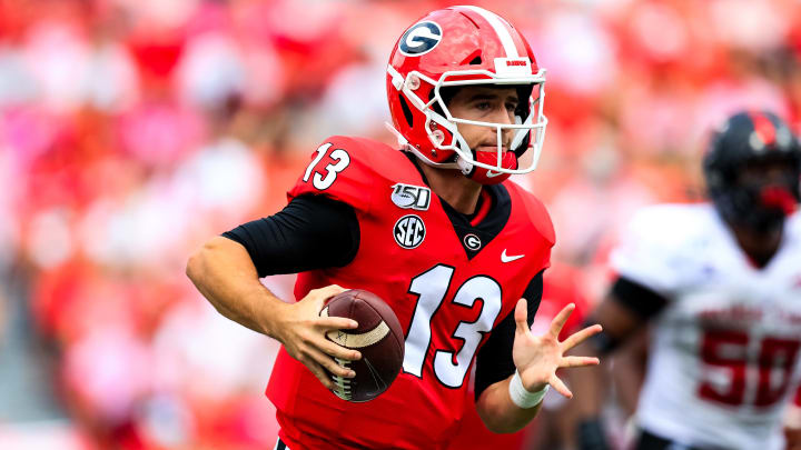 Georgia QB Stetson Bennett scrambles with the ball in a game against Arkansas State.
