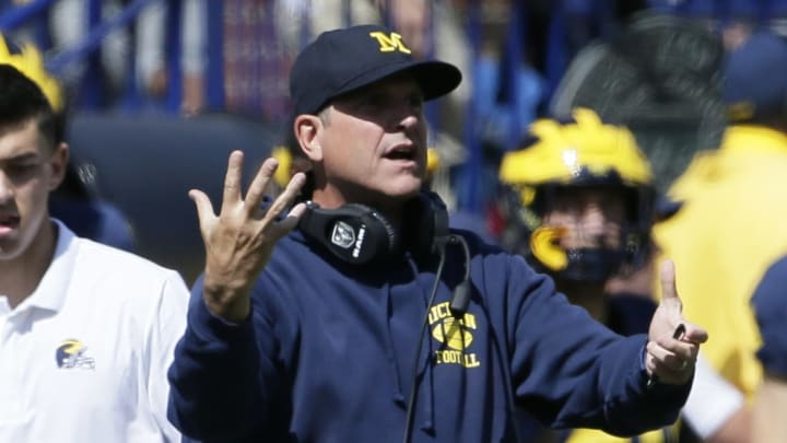 ANN ARBOR, MI - SEPTEMBER 7:  Head coach Jim Harbaugh of the Michigan Wolverines shouts for an official during the first half of a game against the Army Black Knights at Michigan Stadium on September 7, 2019 in Ann Arbor, Michigan. (Photo by Duane Burleson/Getty Images)