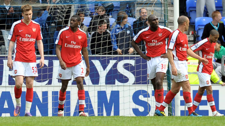 Arsenal players react after conceding a