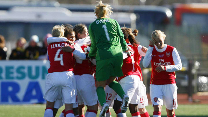 Arsenal's goalie Emma Byrne jumps to joi...