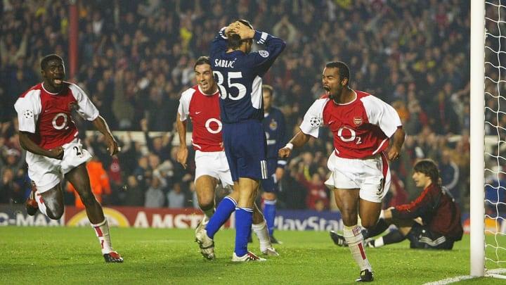 Ashley Cole celebrates scoring the first goal