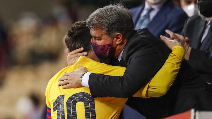 Joan Laporta embraces Lionel Messi