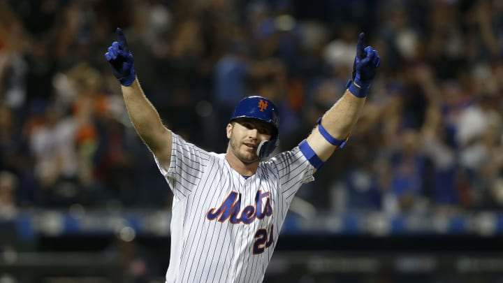 """NEW YORK, NEW YORK - SEPTEMBER 28:  Pete Alonso #20 of the New York Mets reacts after his third inning home run against the Atlanta Braves at Citi Field on September 28, 2019 in New York City. The home run was Alonso""""s 53rd of the season, breaking Aaron Judge's rookie record. (Photo by Jim McIsaac/Getty Images)"""