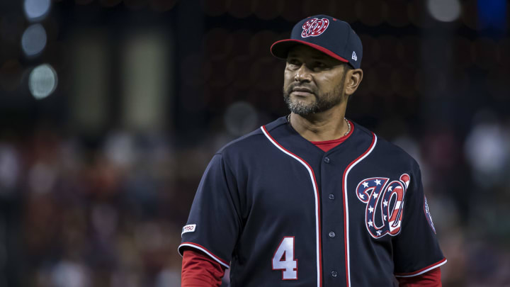 WASHINGTON, DC - SEPTEMBER 13: Dave Martinez #4 of the Washington Nationals walks to the dugout against the Atlanta Braves during the eighth inning at Nationals Park on September 13, 2019 in Washington, DC. (Photo by Scott Taetsch/Getty Images)