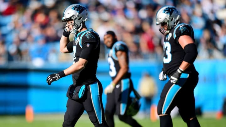CHARLOTTE, NORTH CAROLINA - NOVEMBER 17: Kyle Allen #7 of the Carolina Panthers walks off the field after an interception during the second quarter during their game against the Atlanta Falcons at Bank of America Stadium on November 17, 2019 in Charlotte, North Carolina. (Photo by Jacob Kupferman/Getty Images)