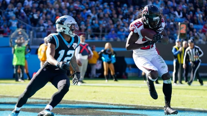 CHARLOTTE, NORTH CAROLINA - NOVEMBER 17: Desmond Trufant #21 of the Atlanta Falcons makes an interception during the second quarter during their game against the Carolina Panthers at Bank of America Stadium on November 17, 2019 in Charlotte, North Carolina. (Photo by Jacob Kupferman/Getty Images)