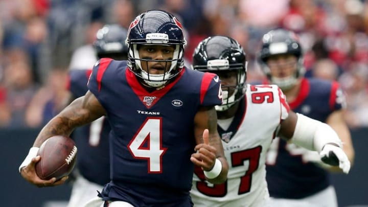 HOUSTON, TX - OCTOBER 06:  Deshaun Watson #4 of the Houston Texans scrambles pursued by Grady Jarrett #97 of the Atlanta Falcons in the second half at NRG Stadium on October 6, 2019 in Houston, Texas.  (Photo by Tim Warner/Getty Images)