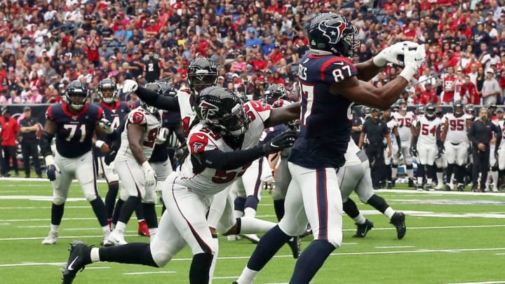 HOUSTON, TEXAS - OCTOBER 06: Darren Fells #87 of the Houston Texans scores on a eight yard pass from Deshaun Watson #4 as  De'Vondre Campbell #59 of the Atlanta Falcons is unable to make a tackle during the third quarter at NRG Stadium on October 06, 2019 in Houston, Texas. (Photo by Bob Levey/Getty Images)