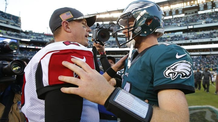 PHILADELPHIA, PA - NOVEMBER 13: Quarterbacks Matt Ryan #2 of the Atlanta Falcons and Carson Wentz #11 of the Philadelphia Eagles meet after their game at Lincoln Financial Field on November 13, 2016 in Philadelphia, Pennsylvania. The Eagles defeated the Falcons 24-15. (Photo by Rich Schultz/Getty Images)