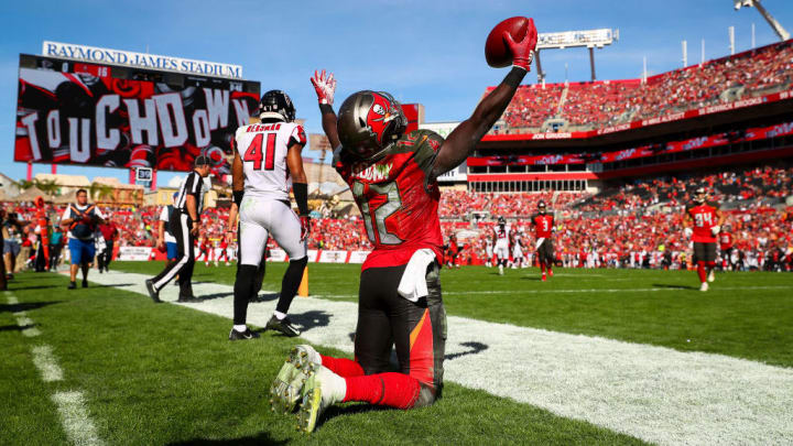 TAMPA, FL - DECEMBER 30: Wide receiver Chris Godwin #12 of the Tampa Bay Buccaneers celebrates his touchdown in the second quarter of the game against the Atlanta Falcons at Raymond James Stadium on December 30, 2018 in Tampa, Florida. (Photo by Will Vragovic/Getty Images)