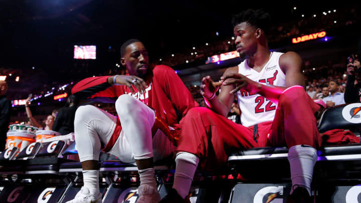 Bam Adebayo (L) and Jimmy Butler (R) talking on the Heat's bench