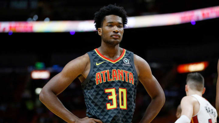 MIAMI, FLORIDA - OCTOBER 14:  Damian Jones #30 of the Atlanta Hawks looks on against the Miami Heat during the first half of the preseason game at American Airlines Arena on October 14, 2019 in Miami, Florida. NOTE TO USER: User expressly acknowledges and agrees that, by downloading and or using this photograph, User is consenting to the terms and conditions of the Getty Images License Agreement.  (Photo by Michael Reaves/Getty Images)