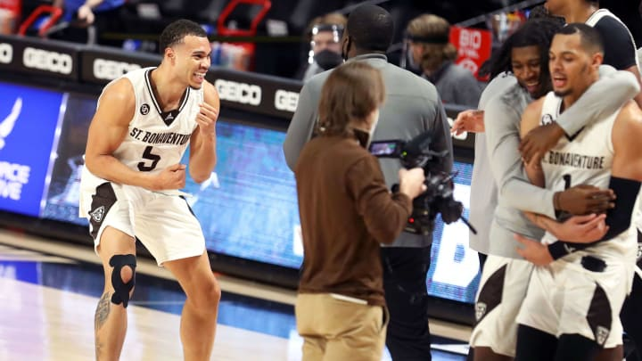 St. Bonaventure winning in the Atlantic 10 semifinals while a photographer captures the action.