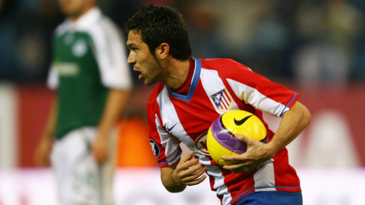 Atletico Madrid's Luis Garcia runs with