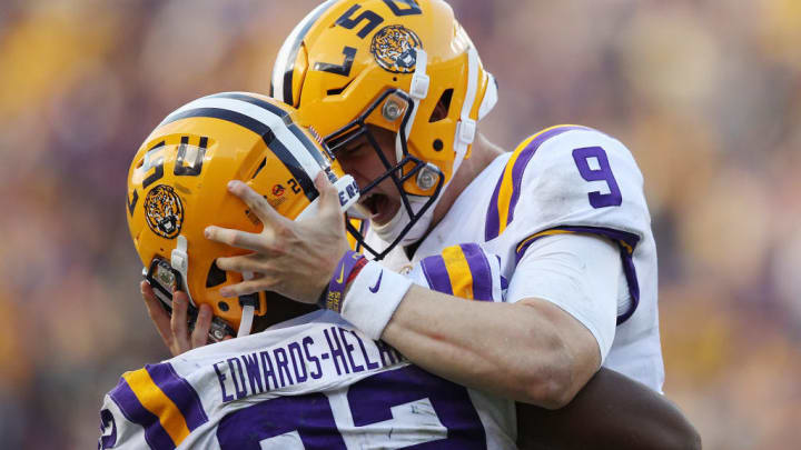 BATON ROUGE, LOUISIANA - OCTOBER 26: Quarterback Joe Burrow #9 of the LSU Tigers celebrates after a touchdown with running back Clyde Edwards-Helaire #22 of the LSU Tigers against the Auburn Tigers at Tiger Stadium on October 26, 2019 in Baton Rouge, Louisiana. (Photo by Chris Graythen/Getty Images)