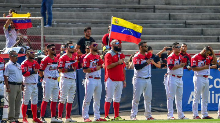 Venezuela's Cardenales de Lara team members sing their national anthem before the Caribbean Series baseball tournament match against Cuba´s Los Leneros de las Tunas at the Rod Carew stadium in Panama City on February 6, 2019. (Photo by Luis ACOSTA / AFP)        (Photo credit should read LUIS ACOSTA/AFP/Getty Images)