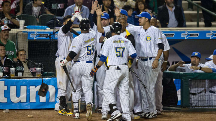 Players of Magallanes of Venezuela celebrates their victory against Yaquis de Obregon of Mexico, during the 2013 Baseball Caribbean Series, on February 2, 2013, in Hermosillo, Sonora State, northern Mexico. AFP PHOTO/Ronaldo Schemidt        (Photo credit should read Ronaldo Schemidt/AFP/Getty Images)