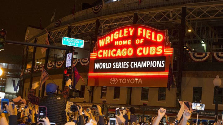 Chicago fans celebrate the Chicago Cubs 8-7 victory over the Cleveland Indians in Cleveland in 10th inning in game seven of the 2016 World Series, outside Wrigley Field in Chicago, Illinois early on November 3, 2016. Ending America's longest sports title drought in dramatic fashion, the Chicago Cubs captured their first World Series since 1908 by defeating the Cleveland Indians 8-7 in a 10-inning thriller that concluded early on November 3. / AFP / Tasos Katopodis        (Photo credit should read TASOS KATOPODIS/AFP via Getty Images)