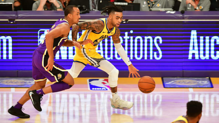 D'Angelo Russell (R) of the Golden State warriors looks to pass under pressure from Avery Bradley (L) of the Los Angeles Lakers during the regular season game at the Staples Center in Los Angeles on November 13, 2019. (Photo by Frederic J. BROWN / AFP) (Photo by FREDERIC J. BROWN/AFP via Getty Images)