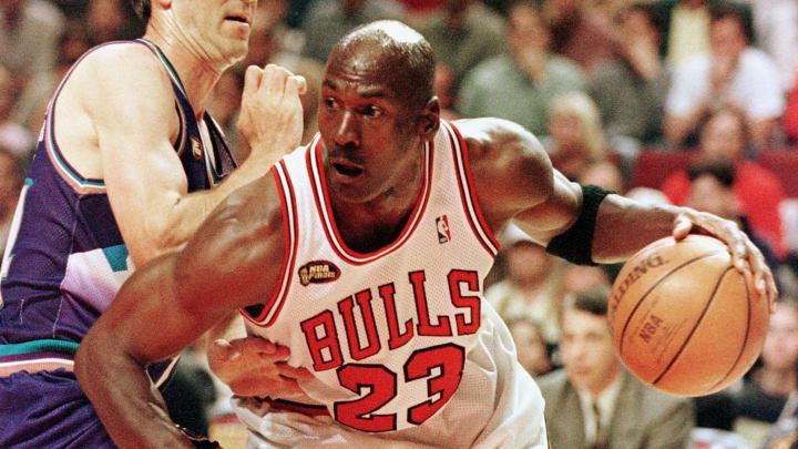 Michael Jordan plays for the Chicago Bulls against the Utah Jazz in the 1998 NBA Finals