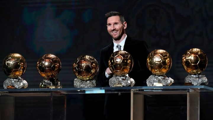 Messi with his six Ballon d'Or awards