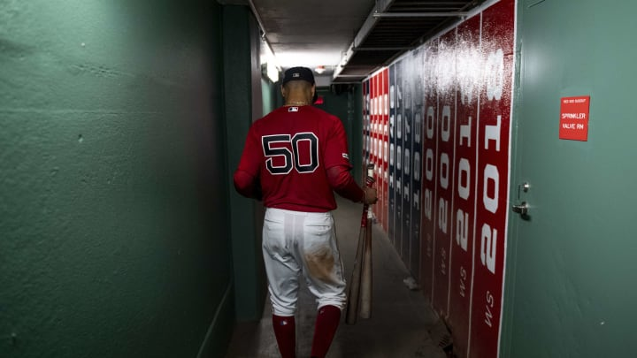 BOSTON, MA - SEPTEMBER 29: Mookie Betts #50 of the Boston Red Sox walks through the tunnel after scoring the game winning run on a walk-off single hit by Rafael Devers #11 during the ninth inning of a game against the Baltimore Orioles on September 29, 2019 at Fenway Park in Boston, Massachusetts. (Photo by Billie Weiss/Boston Red Sox/Getty Images)