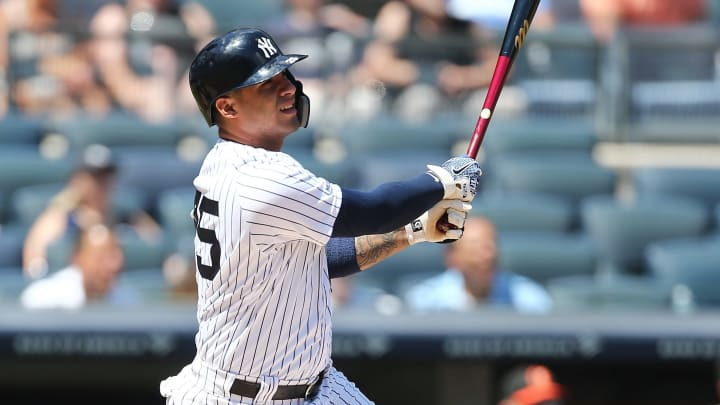 NEW YORK, NEW YORK - AUGUST 12:  Gleyber Torres #25 of the New York Yankees hits a home run to right field in the first inning against the Baltimore Orioles at Yankee Stadium on August 12, 2019 in New York City. (Photo by Mike Stobe/Getty Images)