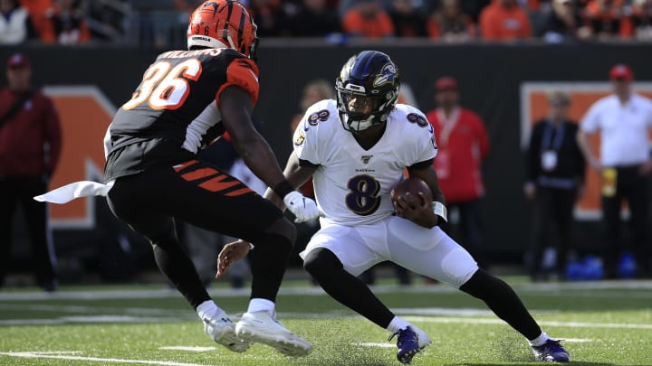 CINCINNATI, OHIO - NOVEMBER 10:  Lamar Jackson #8 of the Baltimore Ravens runs with the ball during the game against the Cincinnati Bengals at Paul Brown Stadium on November 10, 2019 in Cincinnati, Ohio. (Photo by Andy Lyons/Getty Images)