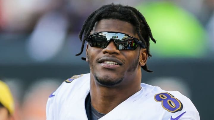 CINCINNATI, OHIO - NOVEMBER 10: Lamar Jackson #8 of the Baltimore Ravens wears sunglasses on the sideline during the fourth quarter of the game against the Cincinnati Bengals at Paul Brown Stadium on November 10, 2019 in Cincinnati, Ohio. (Photo by Silas Walker/Getty Images)