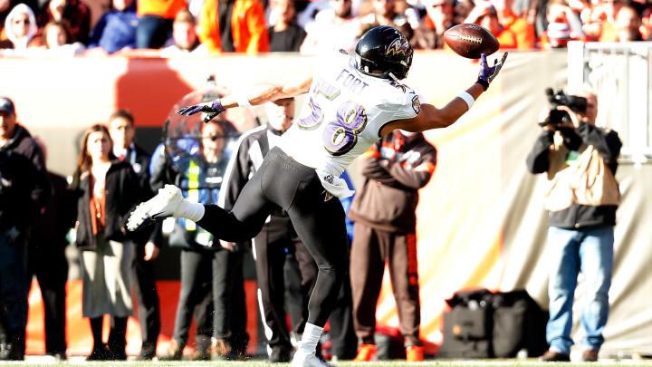 Baltimore Ravens' LJ Fort bobbles a ball against the Cleveland Browns.