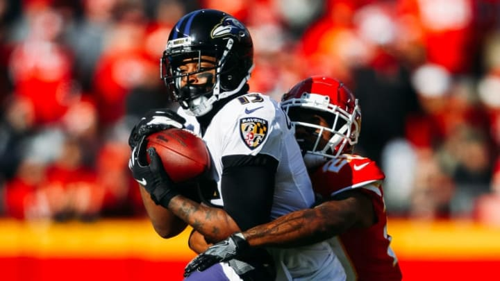 KANSAS CITY, MO - DECEMBER 9: Michael Crabtree #15 of the Baltimore Ravens makes a catch despite tight coverage from Steven Nelson #20 of the Kansas City Chiefs during the first quarter of the game at Arrowhead Stadium on December 9, 2018 in Kansas City, Missouri. (Photo by Jamie Squire/Getty Images)